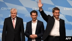 From left, Markus Soeder, Bavaria's State Premier and top candidate of the conservative Christian Social Union party for the regional elections in Bavaria, Austrian Chancellor Sebastian Kurz and German Interior Minister Horst Seehofer take the stage at a final election rally in Munich, Germany, Oct. 12, 2018.