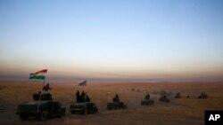 Yon konvwa militè ki gen ladan lame peyi Irak ak group Kurd yo