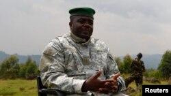 Congolese M23 rebel leader Bisimwa Bertrand speaks to the media in Bunagana, Aug. 2, 2013.
