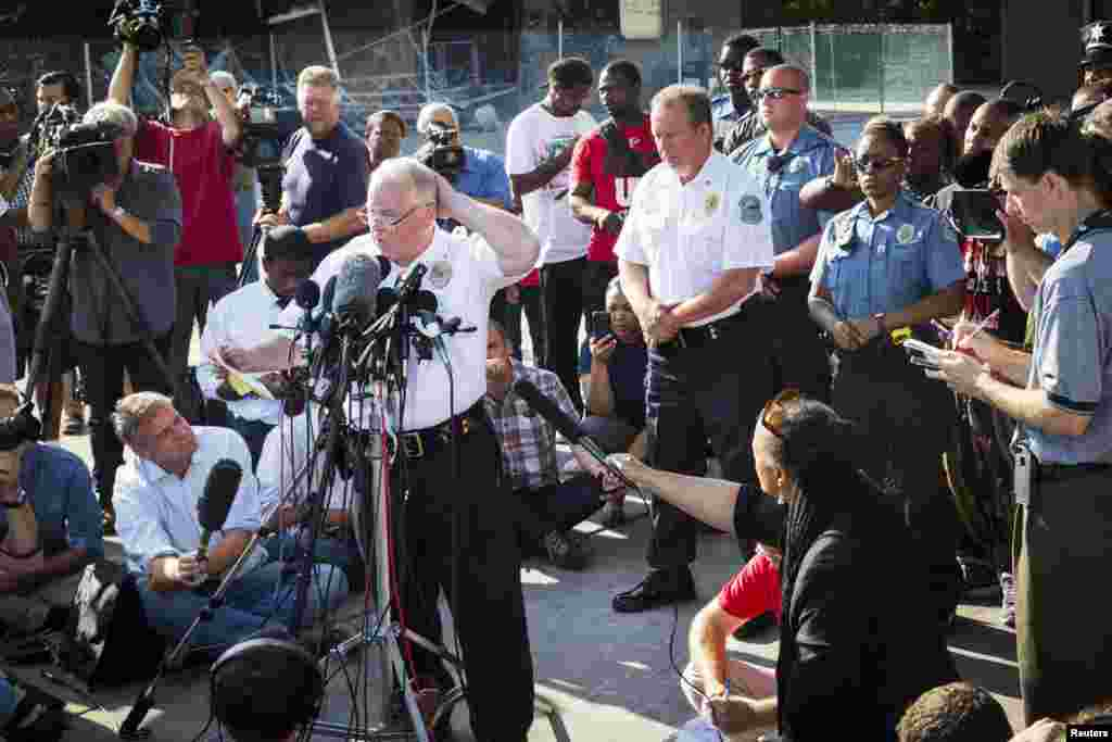 Ferguson Police Chief Thomas Jackson announces the name of Darren Wilson as the officer involved in the shooting of Michael Brown, in Ferguson, Missouri, Aug. 15, 2014.