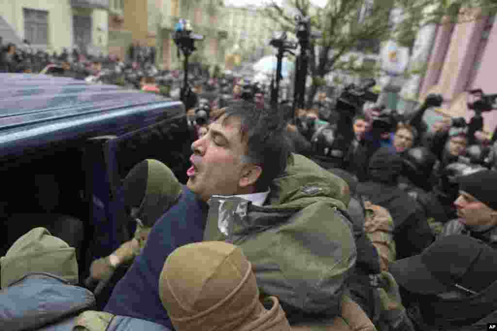 Ukrainian Security Service officers detain former President of Georgia Mikheil Saakashvili at his house in Kyiv. Ukraine's intelligence agency detained Saakashvili, who has emerged as an anti-corruption campaigner in his new country, but faced an angry backlash of protesters who would not let the officers to take him away.