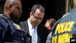 Former Subway pitchman Jared Fogle (C) leaves the Federal Courthouse in Indianapolis, Aug. 19, 2015, following a hearing on child sex and porn charges.