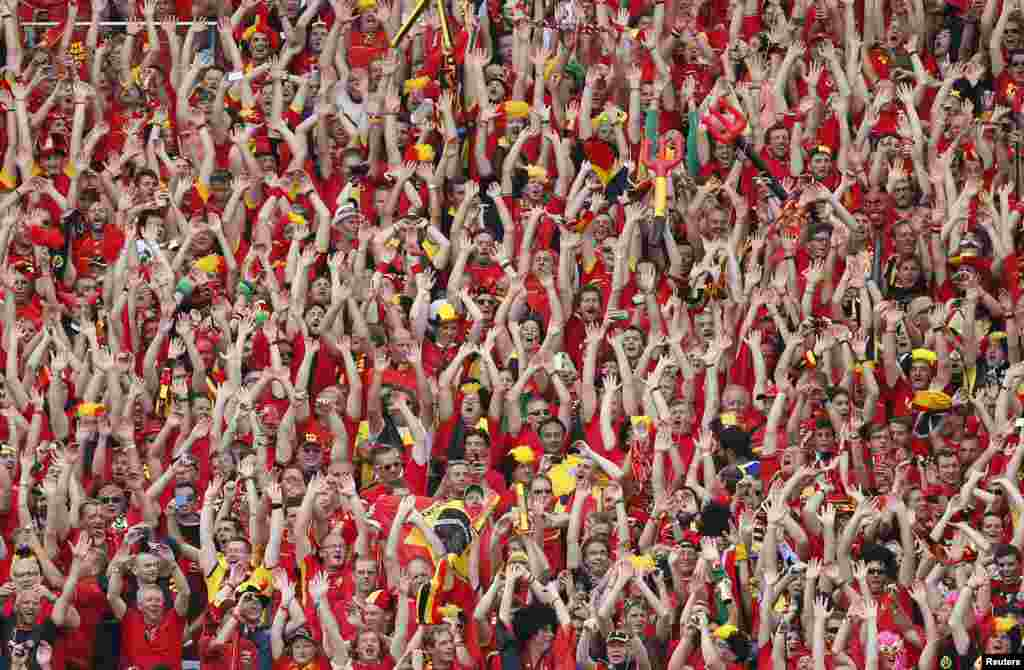 Belgian fans wave during their 2014 World Cup Group H soccer match against Russia at Maracana stadium in Rio de Janeiro June 22, 2014.