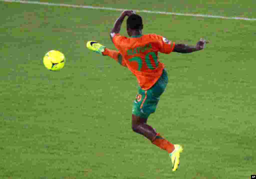 "Mayuka of Zambia kicks to score a goal against Libya during their African Nations Cup Group A soccer match at Estadio de Bata ""Bata Stadium"", in Bata"