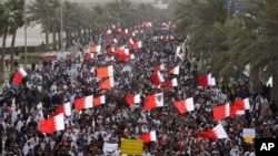 Thousands of anti-government protesters march Tuesday, March 15, 2011, to the Saudi embassy in Manama, Bahrain.