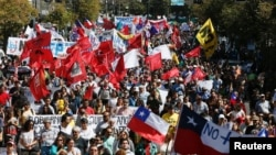 FILE - Demonstrators take part in a protest against national pension system in Valparaiso, Chile, March 26, 2017.