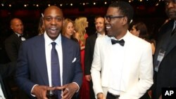Dave Chappelle (l) and Chris Rock appear backstage at the Oscars, Feb. 28, 2016, at the Dolby Theatre in Los Angeles.