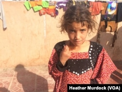 Children here readily describe horrors, like loved ones being kidnapped or beaten by IS and later being arrested and imprisoned in suspicion of supporting the group by the militants' enemies in Iraqi Kurdistan, Oct. 20, 2016.
