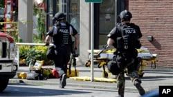 Cảnh sát chạy đến khuôn viên Đại học Seattle Pacific University sau vụ nổ súng, 5/6/14