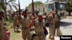 FILE - Members of Iraqi security forces arrive in Anbar Province to reinforce security forces in Ramadi, June 17, 2014.