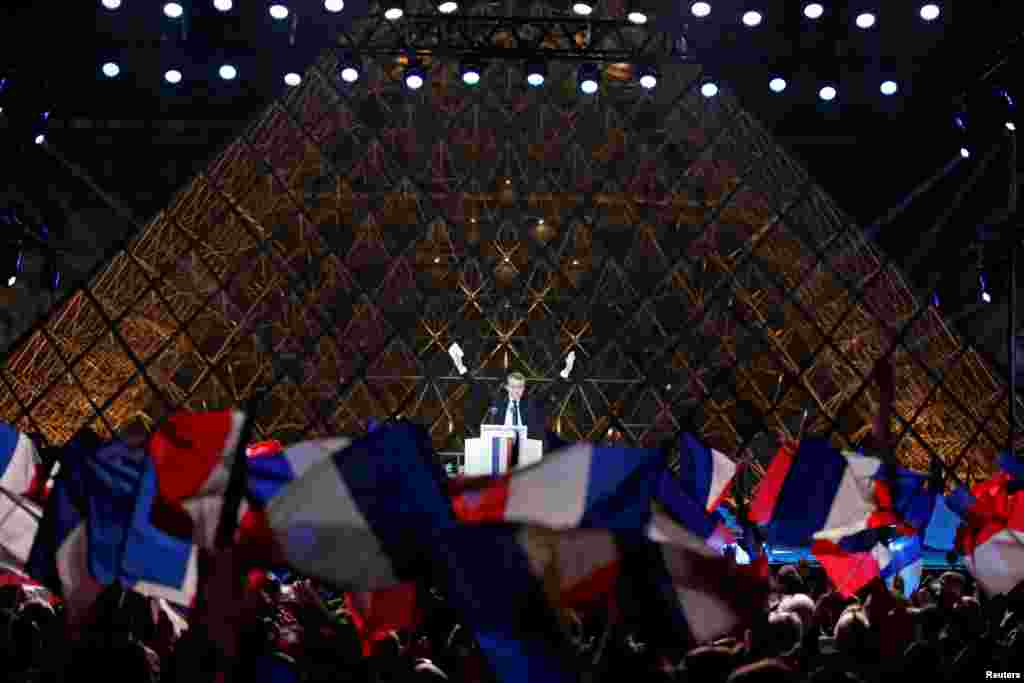 French President-elect Emmanuel Macron celebrates on the stage at his victory rally near the Louvre in Paris, May 7, 2017.
