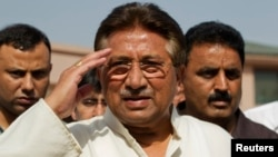 Pakistan's former President and head of the All Pakistan Muslim League (APML) political party Pervez Musharraf salutes as he arrives to unveil his party manifesto for the forthcoming general election at his residence in Islamabad April 15, 2013.