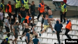 Soccer fans clash in Stade Velodrome, in Marseille, after a match, June 11, 2016.