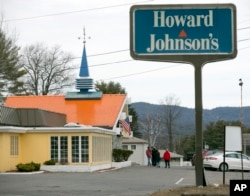 FILE - In this April 8, 2015, file photo, customers walk into Howard Johnson's Restaurant in Lake George, N.Y. The site of the last Howard Johnson's restaurant in the United States. (AP Photo/Mike Groll, File)