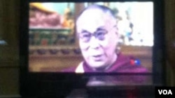 FILE - VOA interview with Dalai Lama as seen on TV screen in Tibet and posted on Wechat, the Chinese social media site.