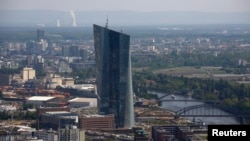 "FILE - The construction site of the new headquarters of the European Central Bank (ECB) is seen from the observation deck of the ""Maintower"" in Frankfurt, April 25, 2014."