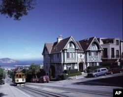 A San Francisco cable car - the nation's only moving national monument, ascends hilly Hyde Street.