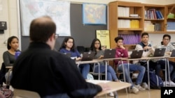 Stuart Wexler leads his Advanced Placement government class in a discussion at Hightstown High School in Hightstown, N.J., Tuesday, Feb. 19, 2019.