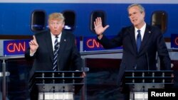 "FILE - Then presidential candidate Donald Trump speaks as former Florida governor and fellow candidate Jeb Bush reacts during the second official Republican presidential debate at the Ronald Reagan Library in Simi Valley, California, Sept. 16, 2015. ""You are never going to be president of the United States by insulting your way to the presidency,"" Bush predicted at the time."