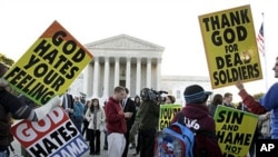 Members of the Westboro Baptist Church picket in front of the Supreme Court in Washington, 06 Oct 2010