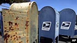 US Postal Service mailboxes are seen awaiting disposal September 1, 2011, in San Jose, California.