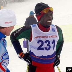 Philip Boit chats with a fan after the race
