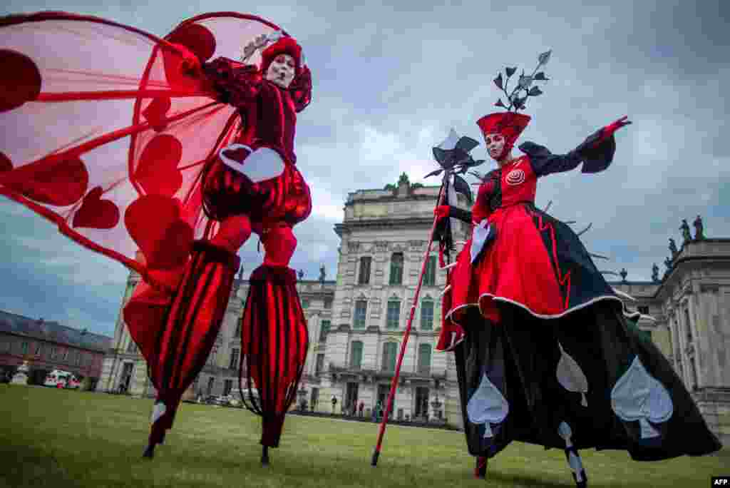 "Dancers of the Art Tremendo dance company perform in front of the Ludwigslust's castle, in northern Germany on to promote the ""Small Festival in a Big Park"" festival this August."
