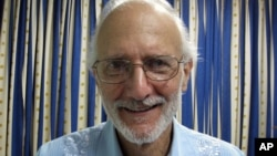 FILE - This Nov. 27, 2012 file photo provided by James L. Berenthal, shows jailed American Alan Gross during a visit by Rabbi Elie Abadie and U.S. lawyer James L. Berenthal at Finlay military hospital as he serves a prison sentence in Havana, Cuba.