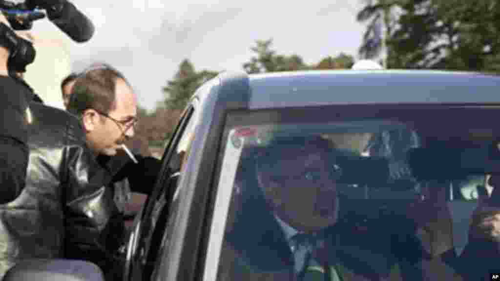 Syrian Information Minister Omran al-Zoubi leaves after meeting with the Syrian opposition at UN headquarters in Geneva, Jan. 27, 2014.