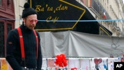 Jesse Hughes of the band Eagles of Death Metal — the band that was playing at the Bataclan concert hall in Paris at the time of the Nov. 13 bombings — pays his respects outside the hall to the 89 victims who died in the attack, Dec. 8, 2015.