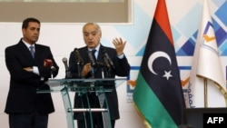 U.N. Special Representative and Head of the U.N. Support Mission in Libya (UNSMIL) Ghassan Salame, right, speaks at a press conference with Emad al-Sayh, the Chairman of the Libyan Electoral Commission in the capital Tripoli, Dec. 6, 2017, during which the commission announced announced the start of the voter registration process and the updating of the electoral register.