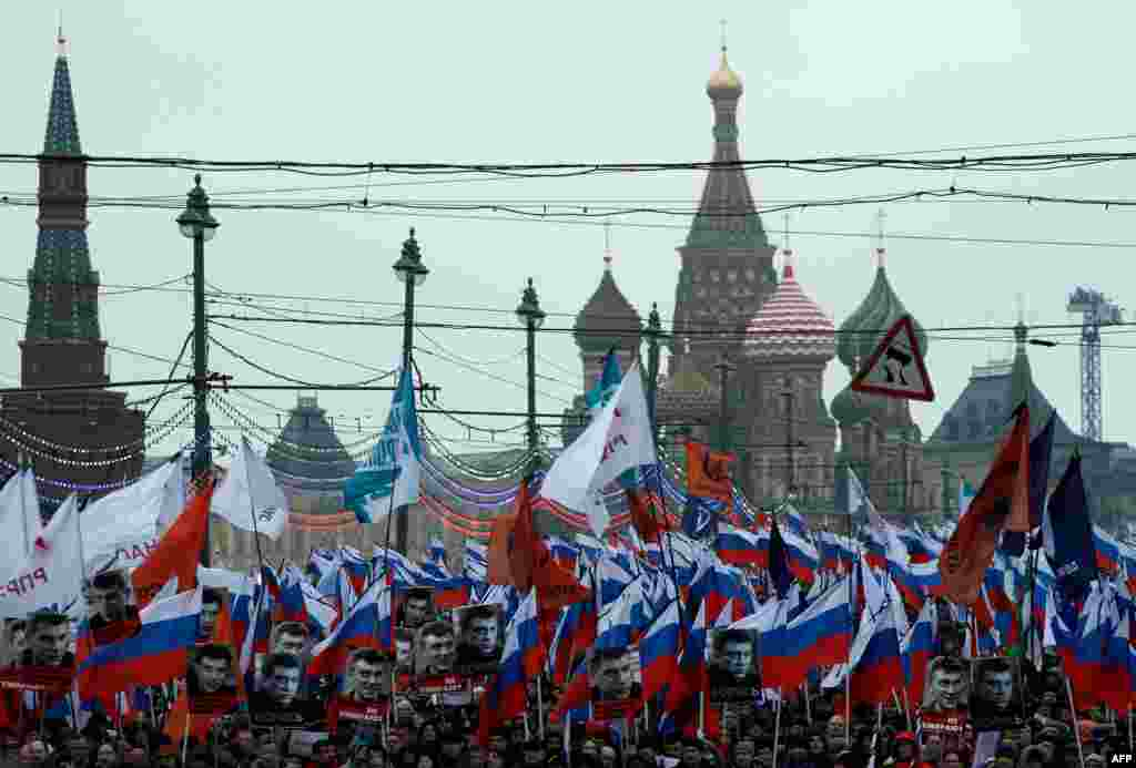 Russia's opposition supporters march in memory of murdered Kremlin critic Boris Nemtsov in central Moscow . The 55-year-old former first deputy prime minister under Boris Yeltsin was shot in the back several times just before midnight on Feb. 27 as he walked across a bridge a stone's throw from the Kremlin walls.
