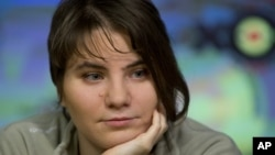 Yekaterina Samutsevich, a member of anti-Kremlin punk feminist band Pussy Riot, who was given a suspended sentence and freed this week by an appeals court, gives an interview in Moscow, October 12, 2012.