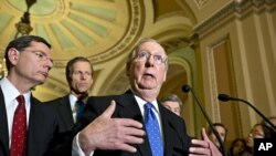 Senate Minority Leader Mitch McConnell speaks with reporters on Capitol in Washington, Nov. 27, 2012.