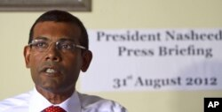 FILE - Former Maldives' President Mohammed Nasheed speaks during a press conference in Male, Maldives, Aug. 31, 2013.
