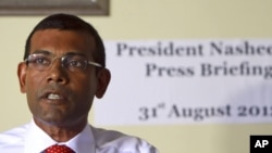 Former Maldives' President Mohamed Nasheed speaks during a press conference after the commission of national inquiry released its report in Male, Maldives, which concluded that Nasheed's resignation was legal, and not forced at gunpoint as he claimed.