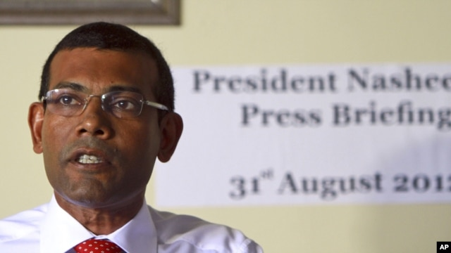 Former Maldives' President Mohammed Nasheed speaks during a press conference after the commission of national inquiry released its report in Male, Maldives, which concluded that Nasheed's resignation was legal, and not forced at gunpoint as he claimed. Na