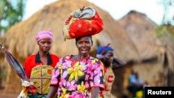 Women from Bunia in eastern Democratic Republic of Congo walk within the Kyangwali refugee settlement in Hoima district in Western Uganda, March 25, 2014.
