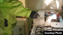 A Drug Enforcement Agency (DEA) officer investigates a suspected fentanyl crime scene (Photo courtesy of DEA)