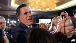 Republican presidential candidate, former Massachusetts Gov. Mitt Romney, greet supporters at his Super Tuesday primary night rally in Boston, Tuesday, March 6, 2012.