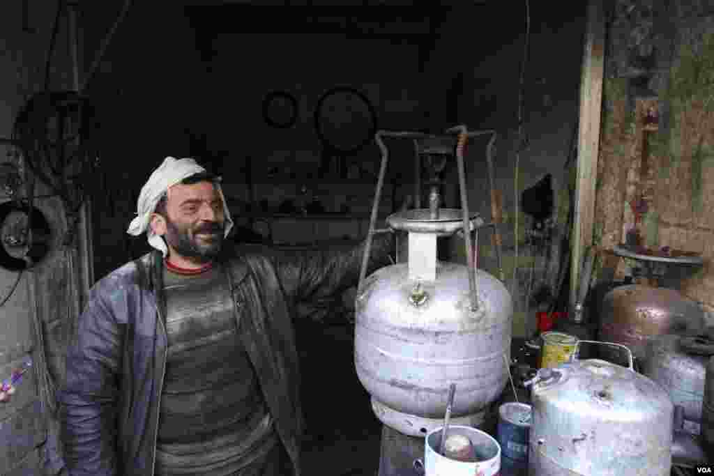 A man sells gas stoves in Aleppo, Syria, Feb. 28, 2013.