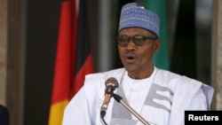 """FILE - """"I, again, call on our brothers in [the Niger Delta] who have taken to violent disruptions of economic infrastructure to come to the negotiating table,"""" Nigeria's Muhammadu Buhari said in a New Year's message."""
