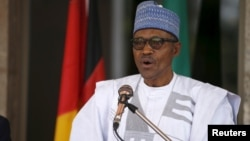 FILE - Nigerian President Muhammadu Buhari frequently talks about ending the country's dependency on oil exports by boosting local food production. On Thursday a tomato processing plant closed.