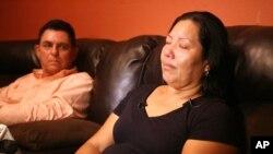Raquel Alvarado is comforted as she talks about her three children, Erica Maria Alvarado Rivera, Alex Rivera, and Jose Angel Rivera, Thursday, Oct. 30, 2014, in Progreso, Texas who were found dead near Matamoros, Mexico after visiting El Control.