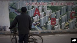 중국 베이징 외곽의 아파트 건설 계획 조감도. 중국의 지난 분기 경제성장률이 2년만에 반등했다.