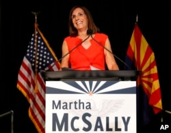U.S. senatorial candidate and U.S. Rep. Martha McSally, R-Ariz., celebrates her primary election victory in Tempe, Ariz., Aug. 28, 2018.