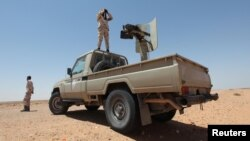 FILE - Libyan forces allied with the U.N.-backed government patrol to prevent Islamic State resurgence on the outskirts of Sirte, Libya, Aug. 4, 2017.