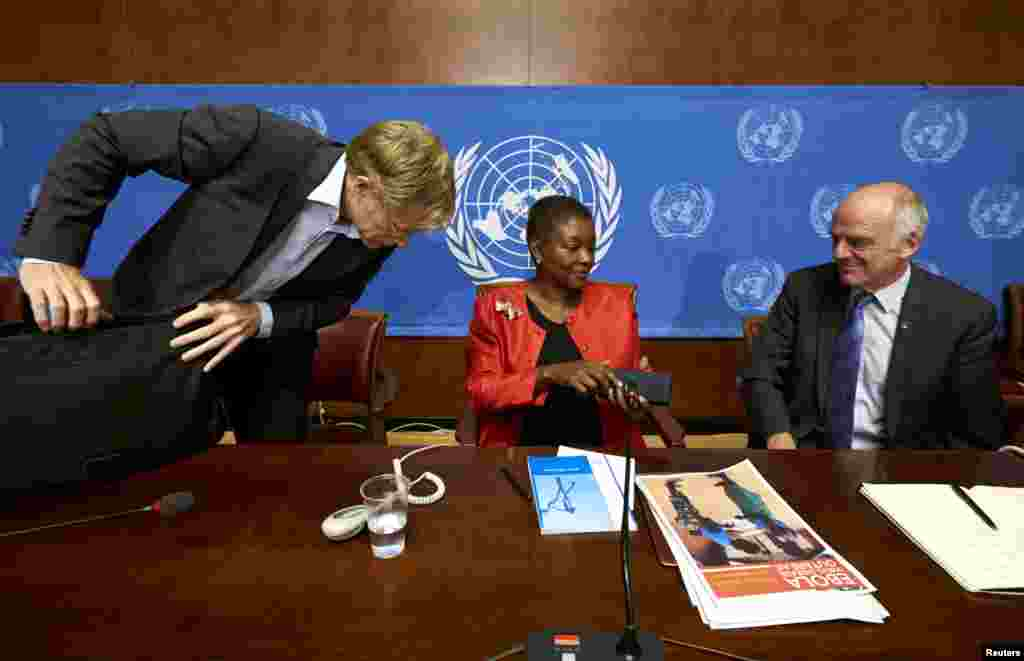 U.N. humanitarian chief Valerie Amos, center, speaks with World Health Organization Assistant Director General Bruce Aylward, left, and Dr. David Nabarro, senior U.N. coordinator for Ebola, after a news conference on Ebola at the United Nations in Geneva, Switzerland, Sept. 16, 2014.