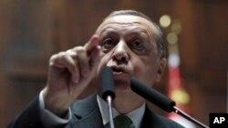 Turkey's President Recep Tayyip Erdogan addresses lawmakers at the parliament in Ankara, Turkey, Jan. 16, 2018. (AP Photo/Burhan Ozbilici)