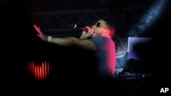 FILE - Rapper Nelly preforms on stage during a Corner Block Party concert at Auburn University, Saturday, April 18, 2015, in Auburn, Alabama.